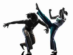 Couple capoeira dancers dancing   silhouette Stock Photos
