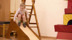 Boy playing in the nursery. Stock Footage