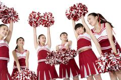 Cheerleaders practicing a cheer - stock photo