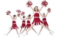 Cheerleaders performing a routine Stock Photos