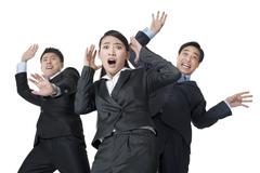 A team of businesspeople are blown away Stock Photos