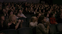 Audience applauding, during a spectacular event - stock footage