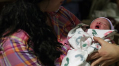 Female holding newborn baby in arms Stock Footage