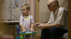 Grandfather and childred playing. Stock Footage