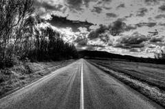 straight road to the clouds - stock photo