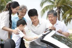 Family Planning their Road Trip Route Stock Photos
