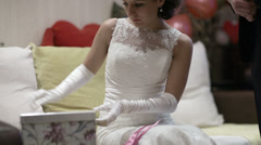 Bride opening wedding gift. Stock Footage