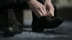 Man tying shoes. - stock footage