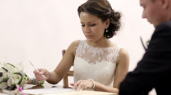Bride signing marriage license. Stock Footage