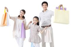 Family Holding Shopping Bags Stock Photos