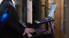 Person playing an electronic keyboard Stock Footage