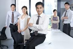 Muotokuva luottavainen liiketoiminnan Team Kuvituskuvat