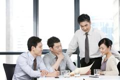 Business Executive Going Over Business Team's Ideas - stock photo