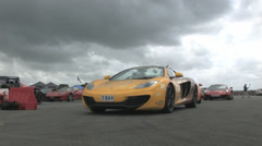 3 Mclarens at start line. Stock Footage
