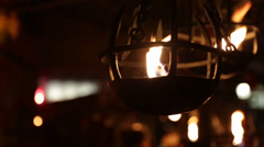Market booth fire bowl flickering Stock Footage