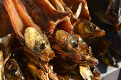 smoked omul fish for sale - stock photo