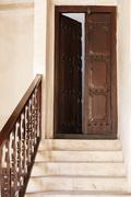 stone staircase and wooden door ajar - stock photo