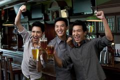 Friends Watching Sports at a Bar Stock Photos