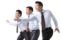 Businessman Racing Against Each Other - stock photo