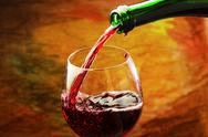 Stock Photo of red wine being poured into wine glass