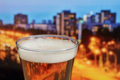 glass of beer  in a landscape - stock photo