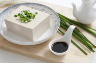 Stock Photo of Tofu in a bowl with soysauce and leeks