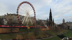Ferris wheel and Scott Monument Edinburgh Scotland Stock Footage