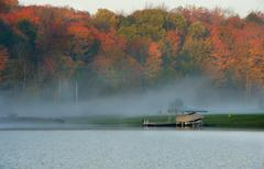Sunrise and mist in beautiful lake in Algonquin Park Stock Photos
