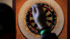 Darts Thrown at Dartboard - Over Shoulder Shot - stock footage
