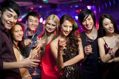 Stylish young people drinking in bar - stock photo