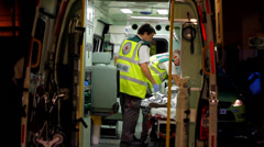 Medics in Back of Ambulance Stock Footage