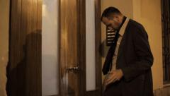 Drunk businessman trying to open the door HD Stock Footage