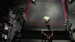 Pro Wrestling Move: Corkscrew Dive to Outside - stock footage