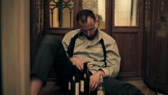 Drunk businessman sitting on the floor and sleeping HD Stock Footage