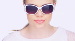 Woman sunglasses puff Stock Footage