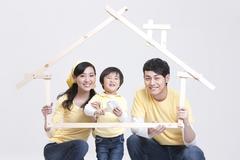 Happy family doing DIY home improvement Stock Photos