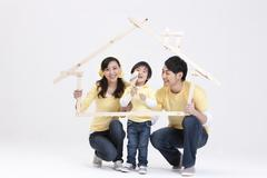 Young family doing home DIY - stock photo