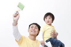 Father and son doing home DIY - stock photo