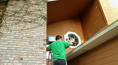 Cleaning Gutters Home Maintenance Stock Footage