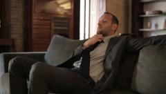 Tired businessman resting on the sofa HD Stock Footage