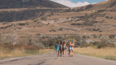 Teenage Girls Give Piggyback Rides And Twirl In Road Stock Footage