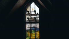 Time lapse of glass artist installing stained glass windows in a church Stock Footage
