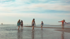 Group Of Teenage Girls Play And Twirl In The Water Stock Footage