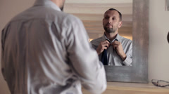Businessman wearing collar shirt in front of the mirror HD Stock Footage