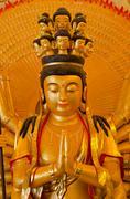 "Golden Bodhisattva ""Guan Yin"" with thousand hands statue Stock Photos"