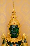 Emerald buddha statue - stock photo