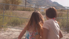 Bad Teenage Girls Climb Fence Stock Footage