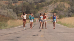 Group of Teenage Girls Walk Arm In Arm Down The Road Stock Footage