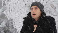 Man Cold Winter Outdoors Freezing Weather Snow Falling - stock footage