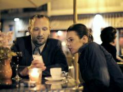 Businessman and businesswoman watching smartphone at the cafe NTSC Stock Footage